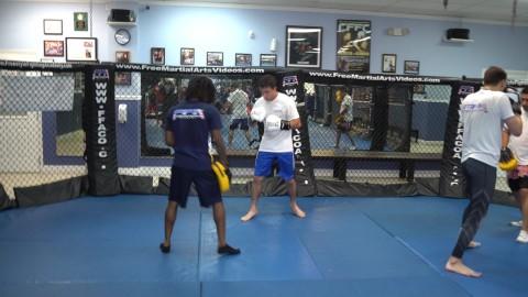 Mitt holding with Adrian Garcia