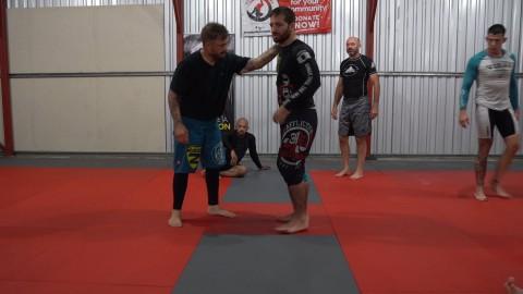 56 – Standing Reverse Kimura Throw